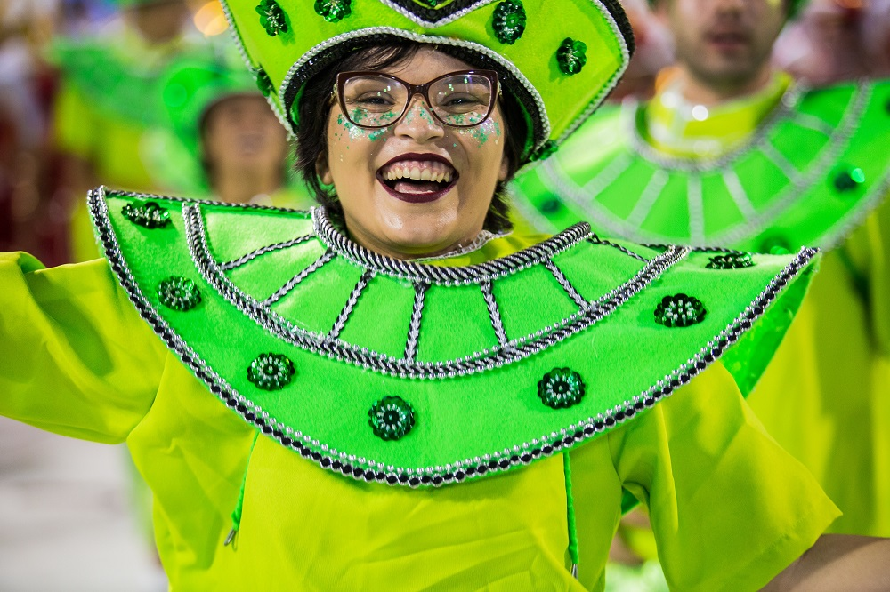 Cheerful girl parading in a samba school costume